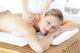 Woman having a deep tissue massage