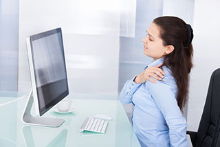 Young office girl with back pain