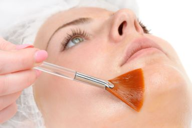 A client having cosmetic skin peels treatments