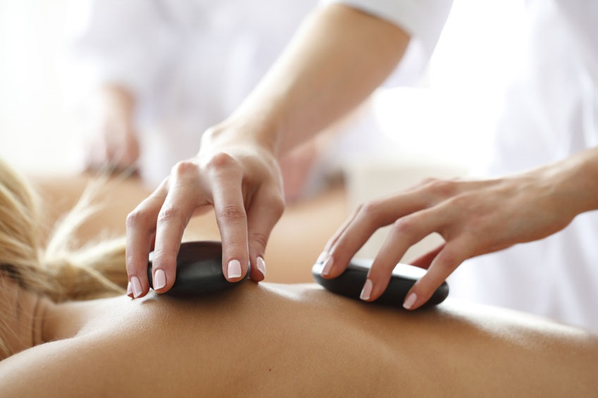 Client receiving a Hot Stone Massage
